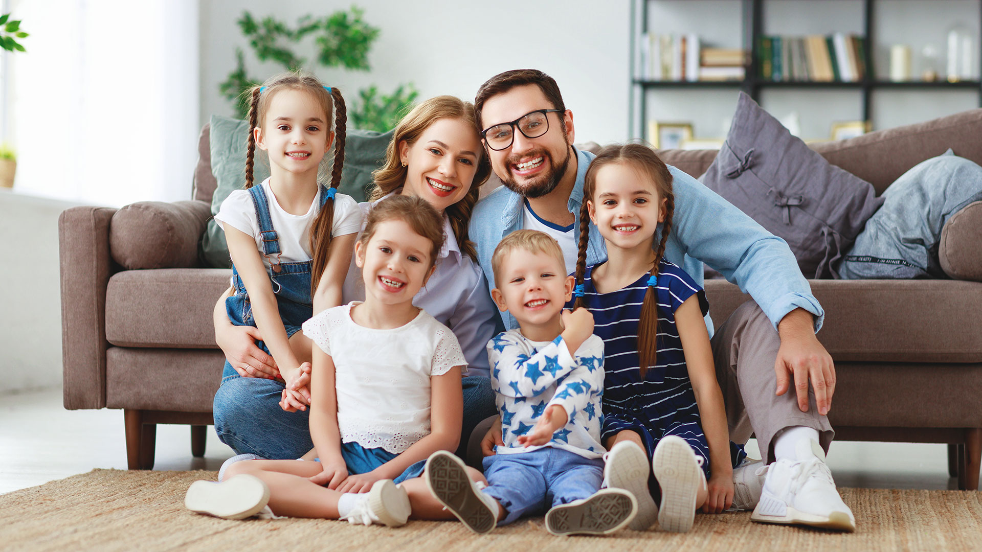 family on floor for family suggestions page